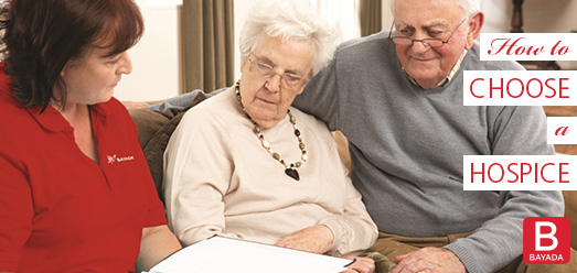 Hospice Patient Discussing Care With Nurse