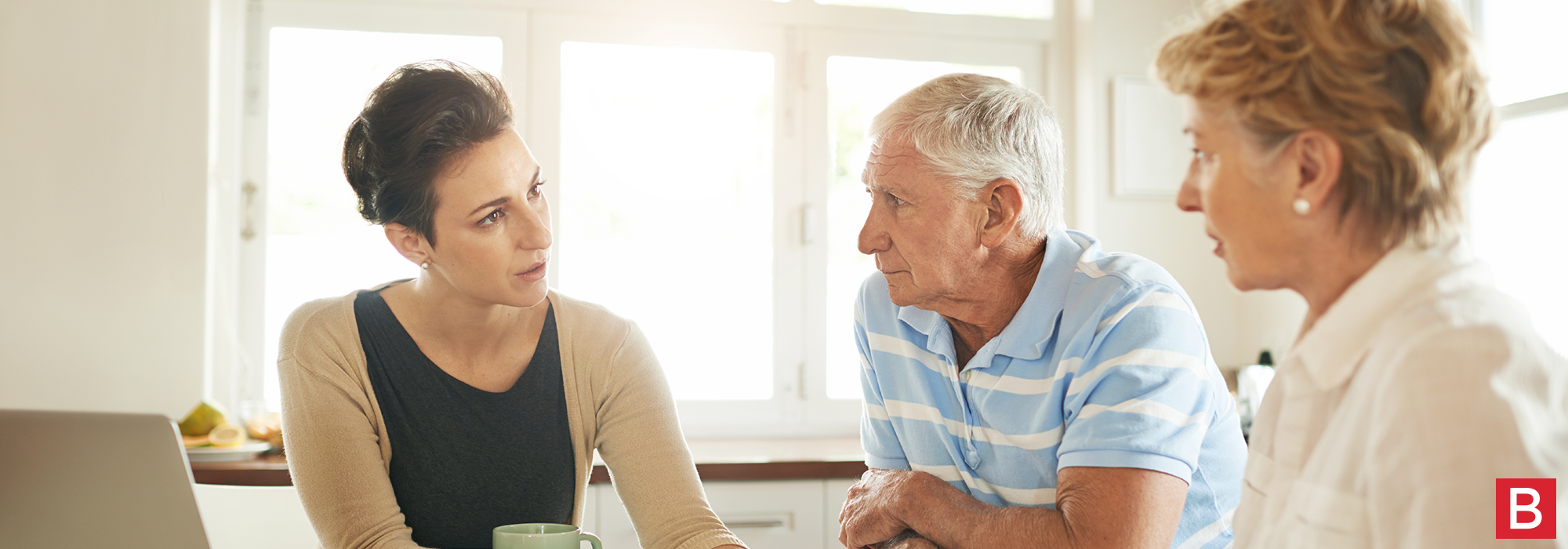 A younger woman consulting an elderly couple about Dementia