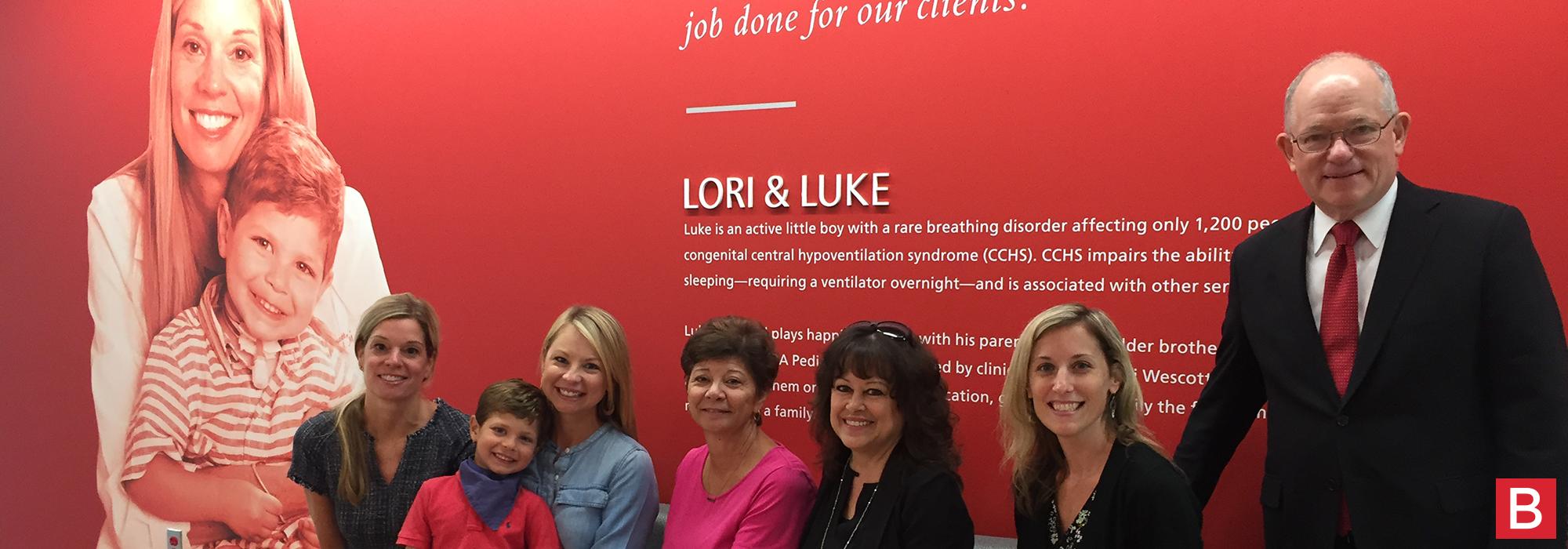 Lori, Luke and family posing with Mark Baiada at the new Pennsauken office