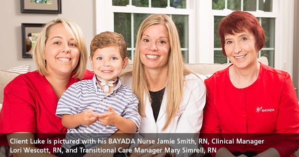 Child client and team of nurses and clinical manager smiling for the camera
