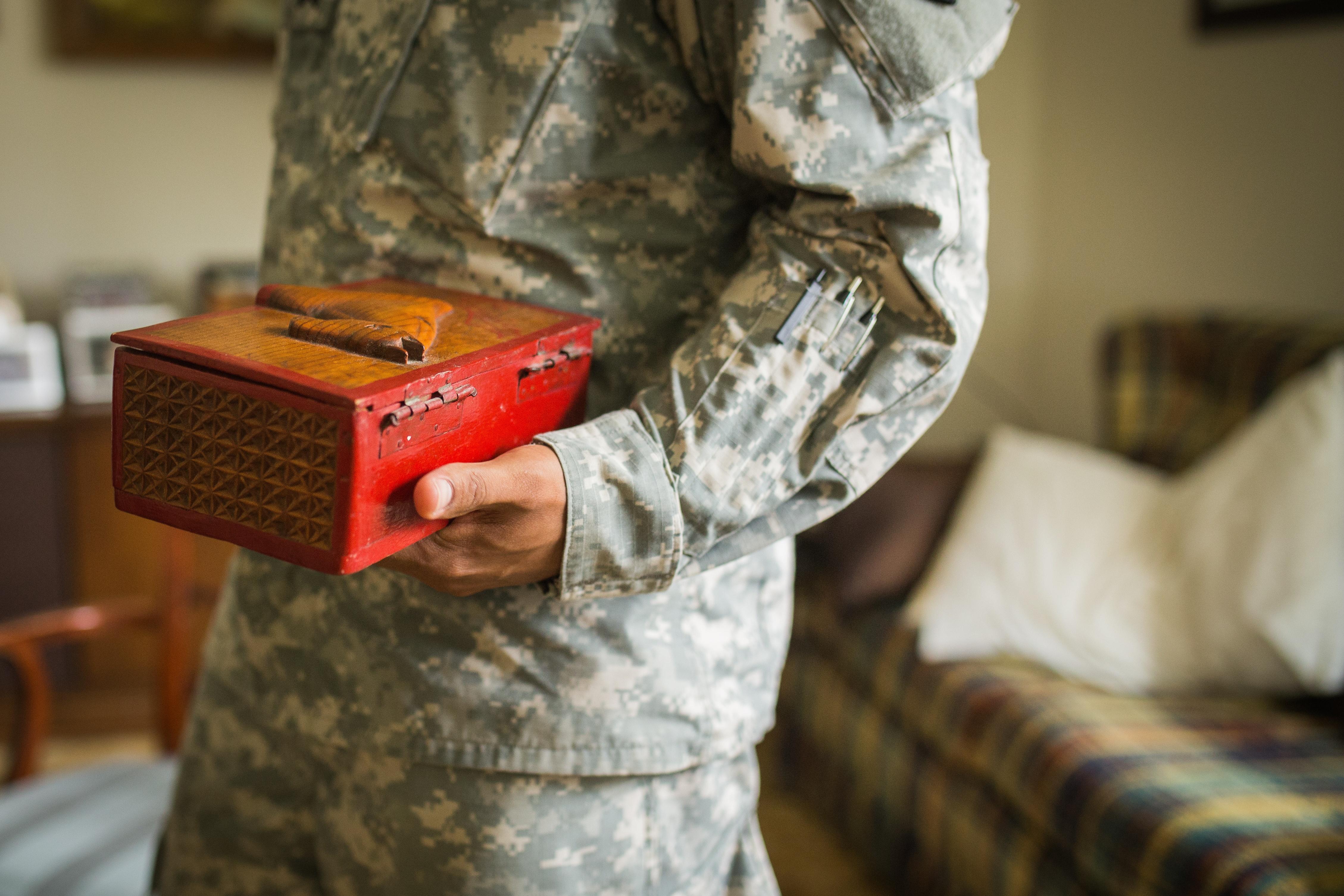 Adrian holding Stewart's box
