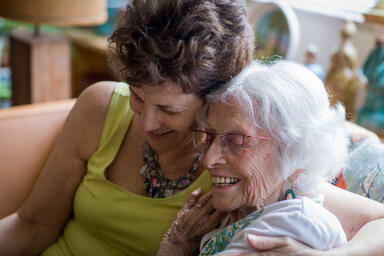 Caring for elderly parents: Family caregiver and their aging parent embrace