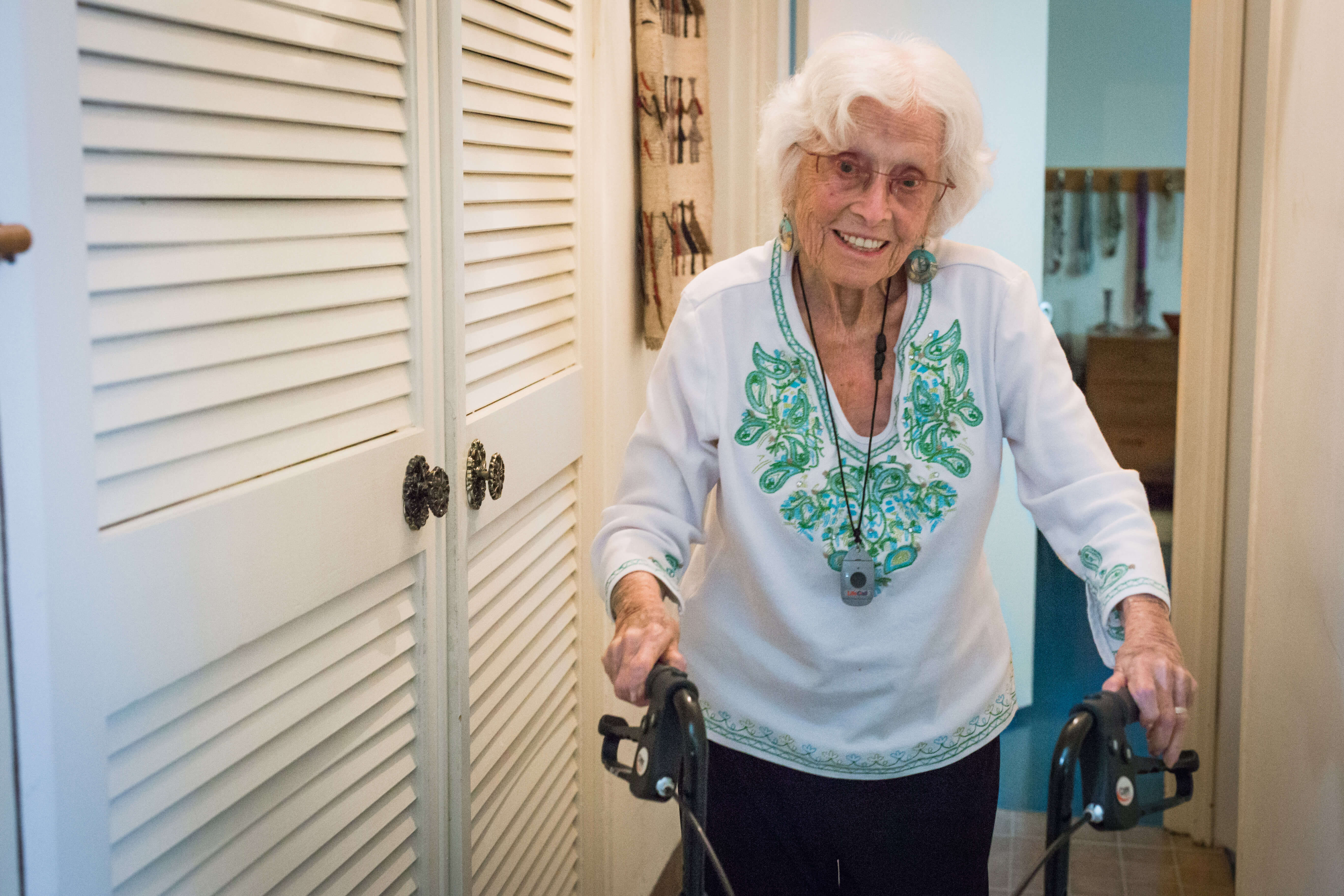 Senior practices fall prevention by using a walker in the home