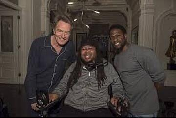 Bryan Cranston, Eric LeGrand, and Kevin Hart pose for a picture.