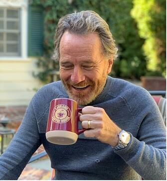 Bryan Cranston drinks coffee out of a LeGrand Coffee House coffee cup
