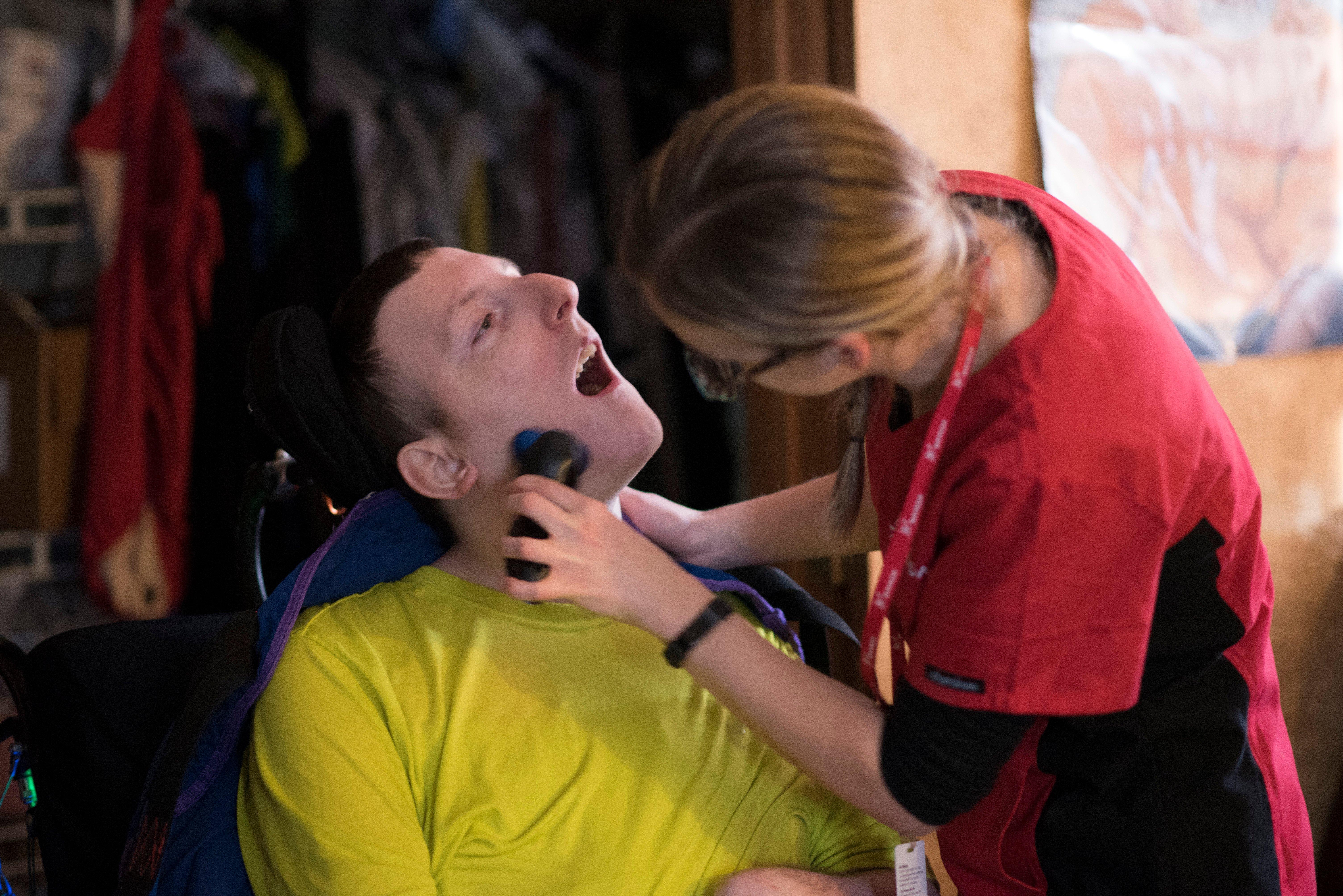 Home health aide duties: photo of a HHA shaving a client