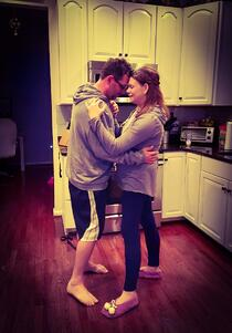 husband and wife dancing in the kitchen